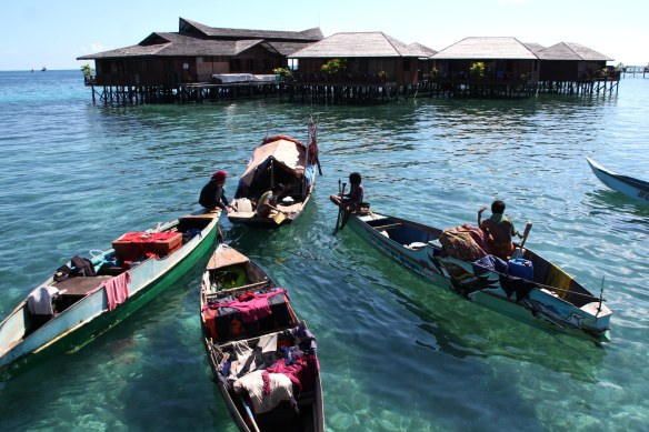 Local boats in front of a resort on Mabul