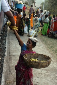 Woman selling bananas to a passenger on the Koraput to Vizag train