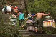 Porters carrying goods up the steps of Huang Shan (Yellow Mountain), Anhui