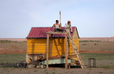 Trying to get mobile reception in the Gobi desert