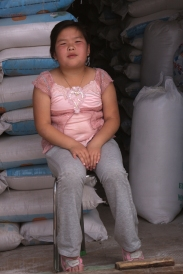 Market in Tsetserleg, Central Mongolia: girl selling flour