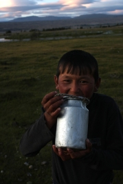 Nomad boy drinking milk beside Khoton lake, Altai Tavan Bogd National Park
