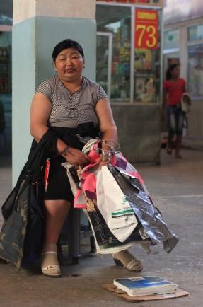 Woman with bags and scales, Naran Tuul 'Black' market, Ulaanbaatar