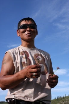 Man with wild flowers, Batshireet, East Mongolia